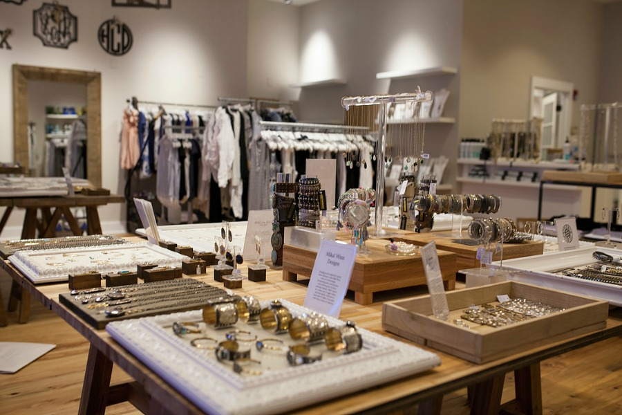 Alixandra Collections indoor store with jewelry and clothes on display
