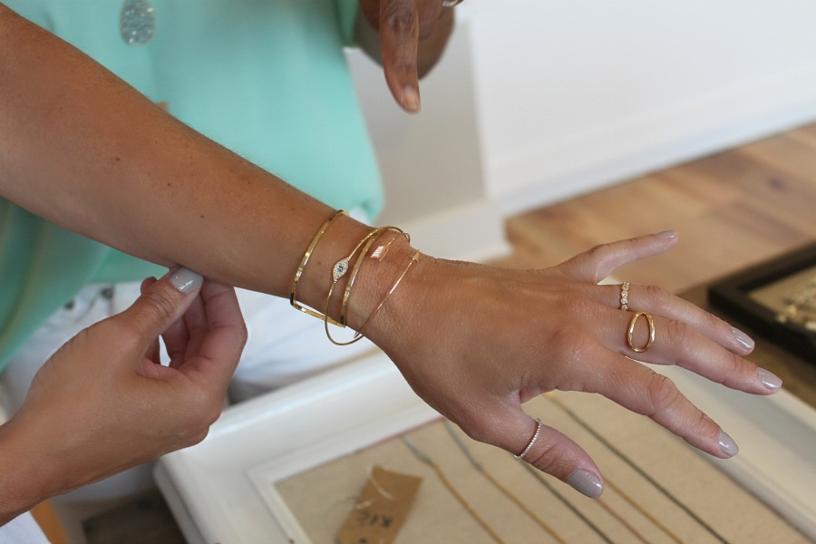 Close-up of two women trying on bracelets