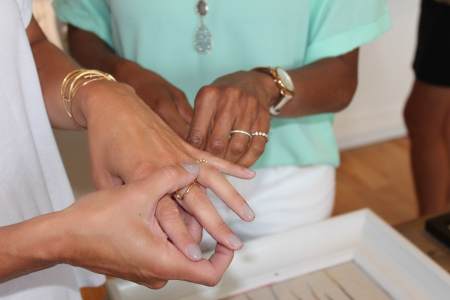 two women trying on rings