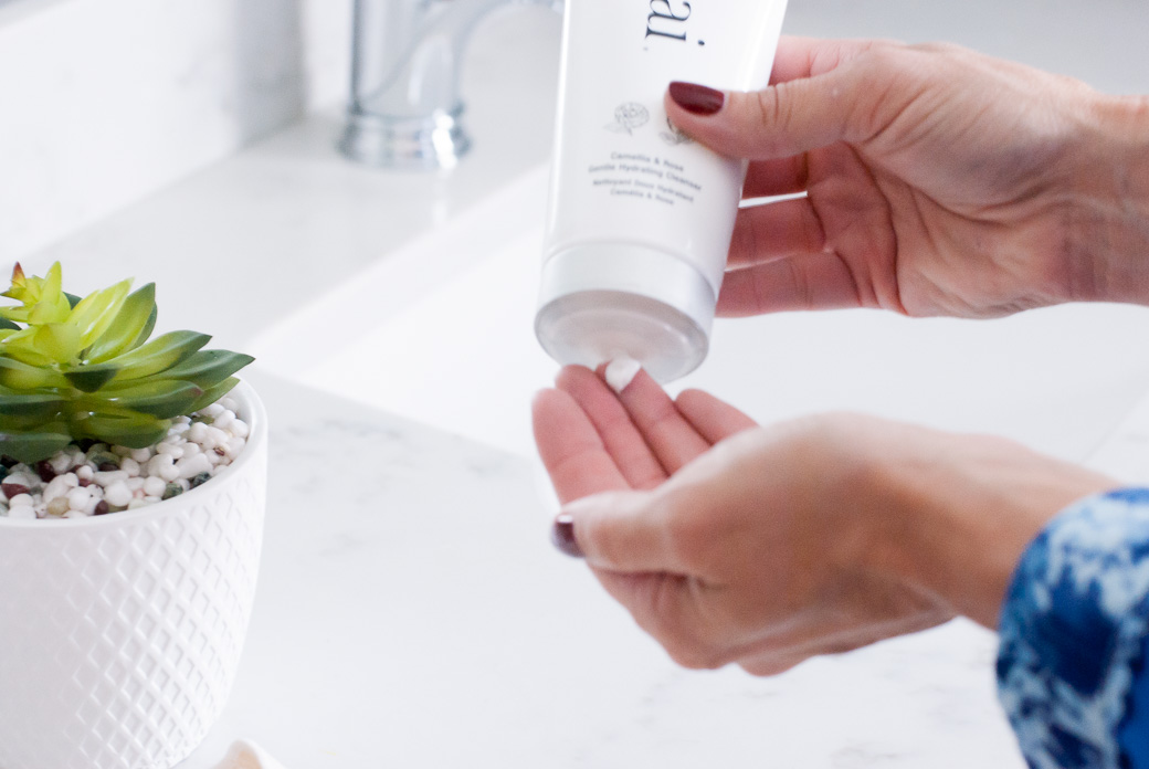 up close of hands using a cleanser