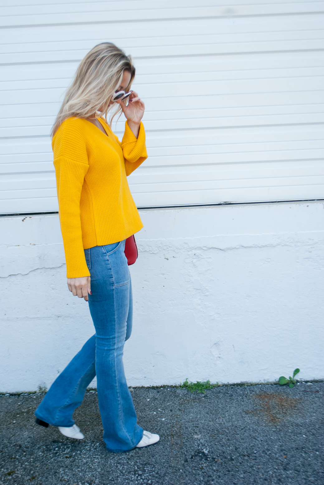 a girl in a marigold fall color sweater
