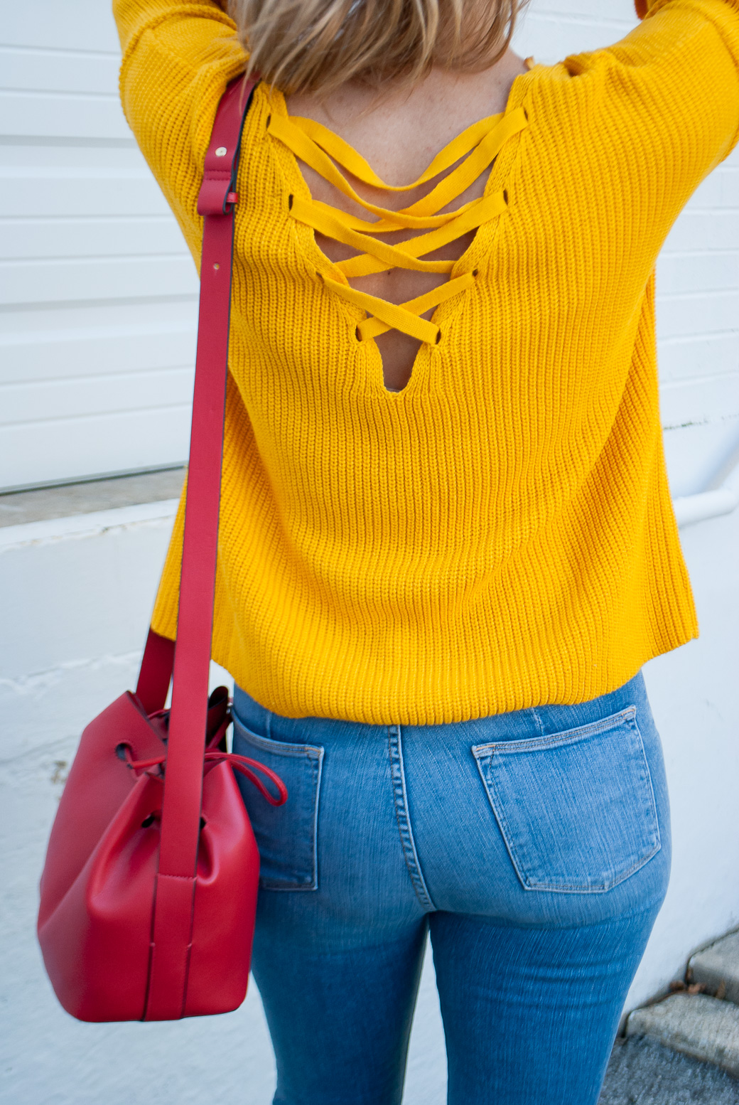 jeans and a sweater and purse
