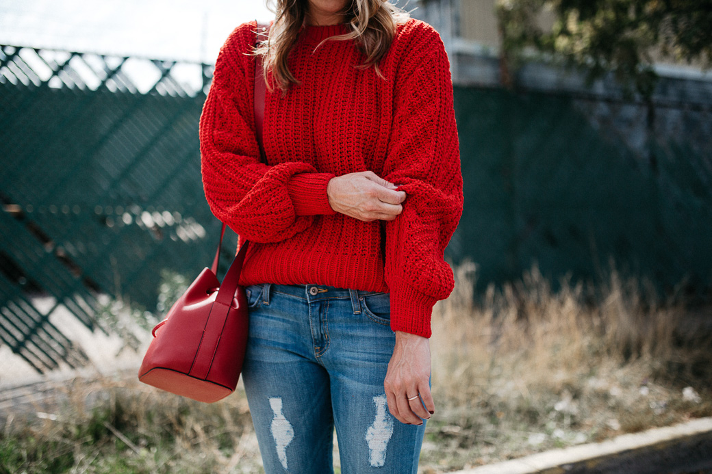 5 Sweaters Needed For Fall include this red sweater that is plush and large to keep you extra warm this fall