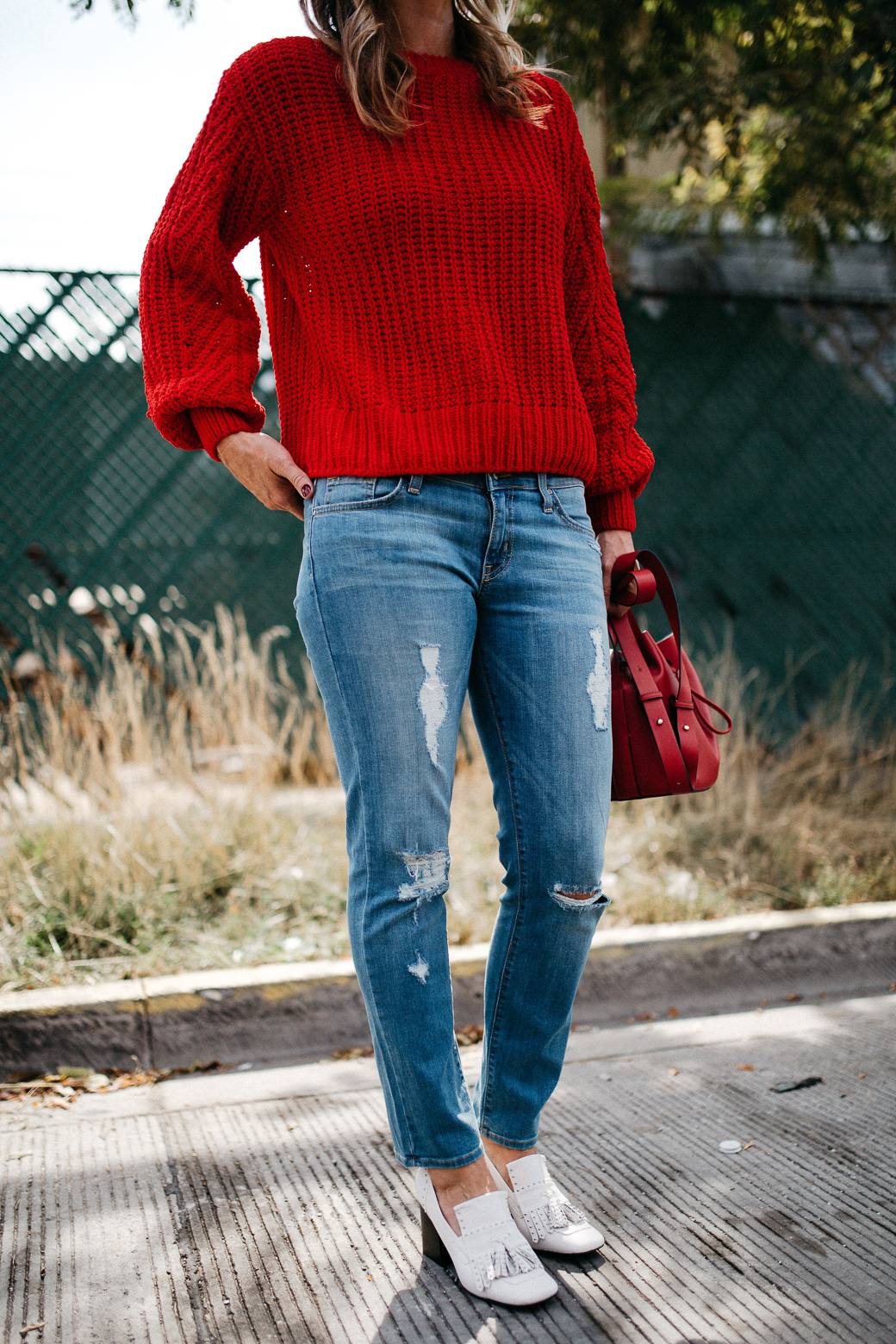 a knitted red sweater with long sleeves and a high neck, 5 Sweaters Needed For Fall
