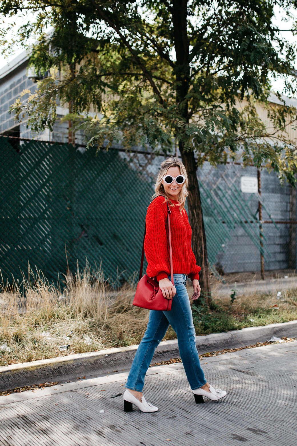 a red sweater with a high neck and sunglasses