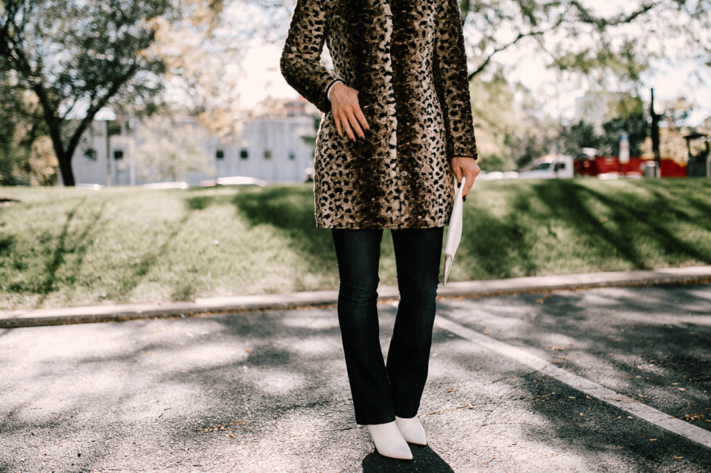 Leopard Print Coat with white boots and white clutch