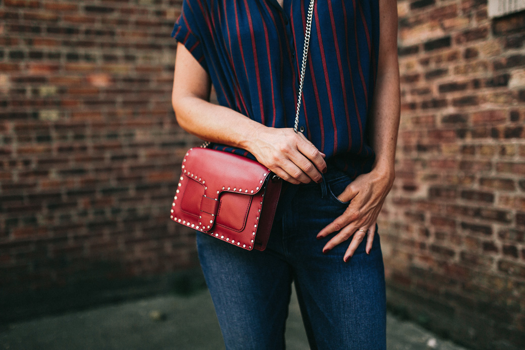 red purse with navy striped top