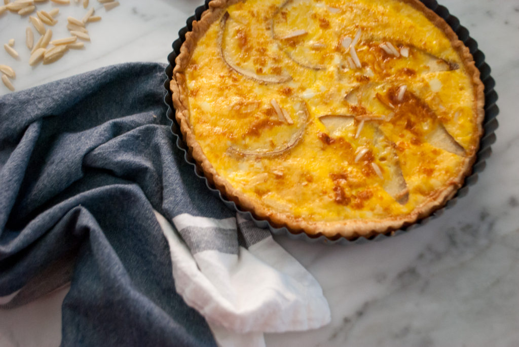 Quiche with sliced pear, slivered almonds and Swiss cheese