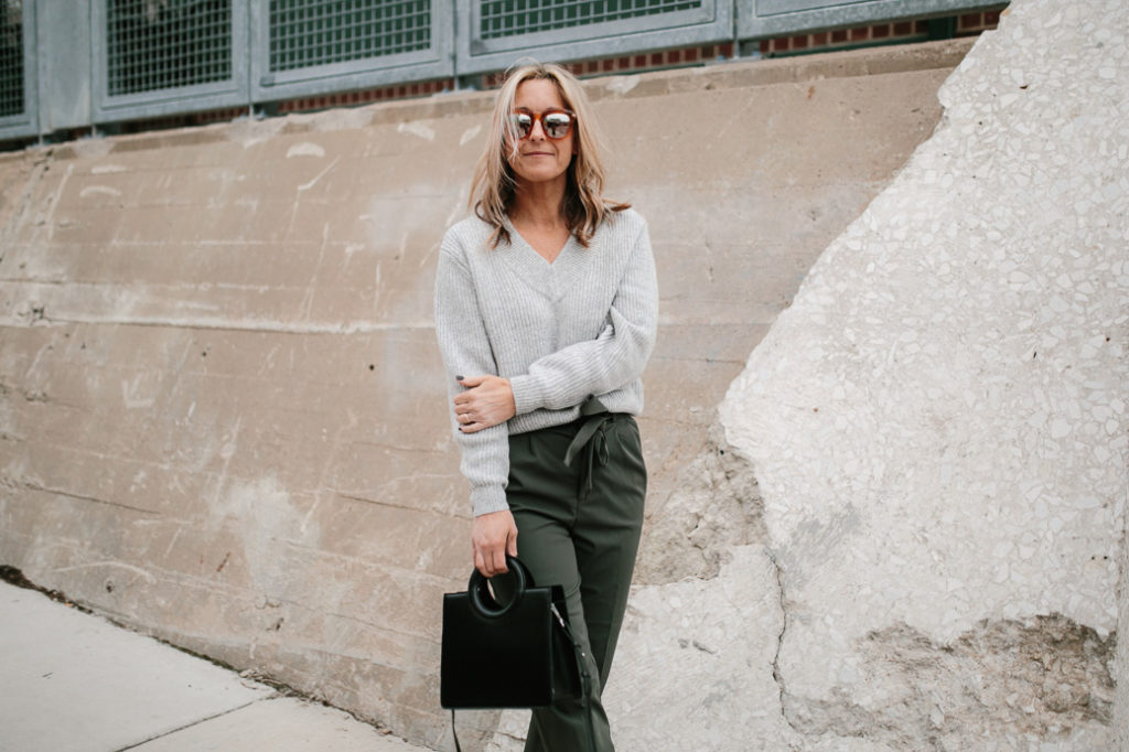 During the winter, style a paper bag pant with a tucked in sweater