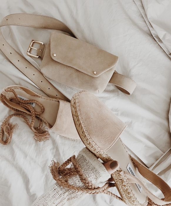 Detailed shot of blush belt bag and espadrilles