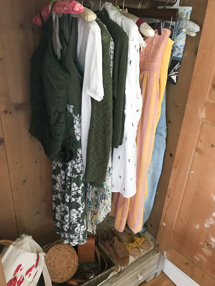 Closet filled with marigold and moss green clothing items