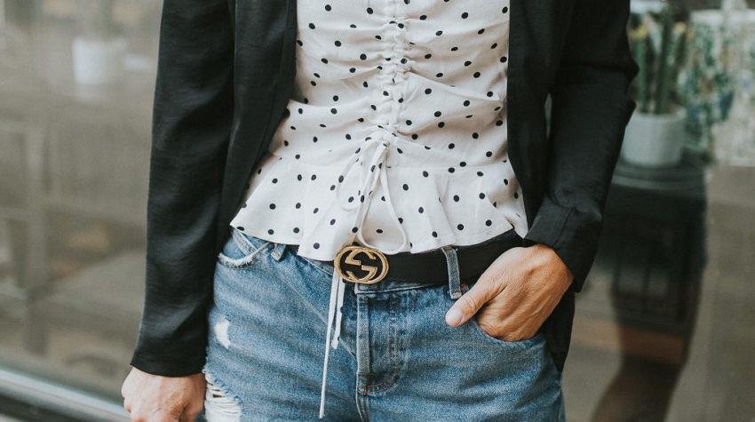 Polka dot top underneath a blazer and denim shorts with a Gucci belt