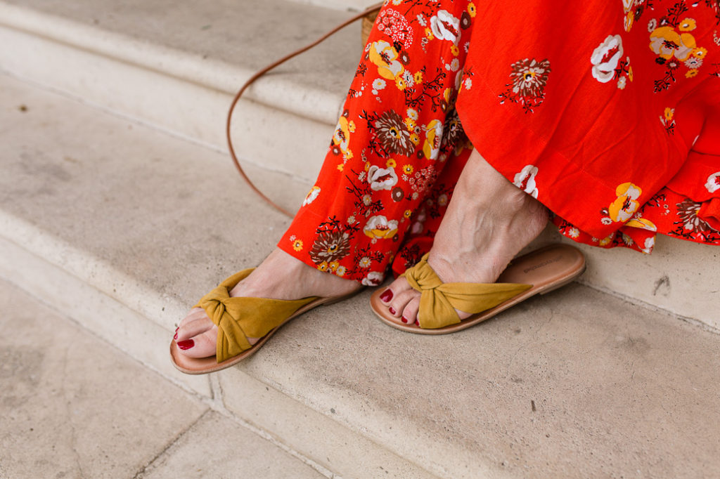 Pair a red floral maxi dress with marigold flats