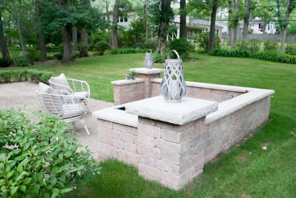 How to build an outdoor patio space with bricks and a fireplace