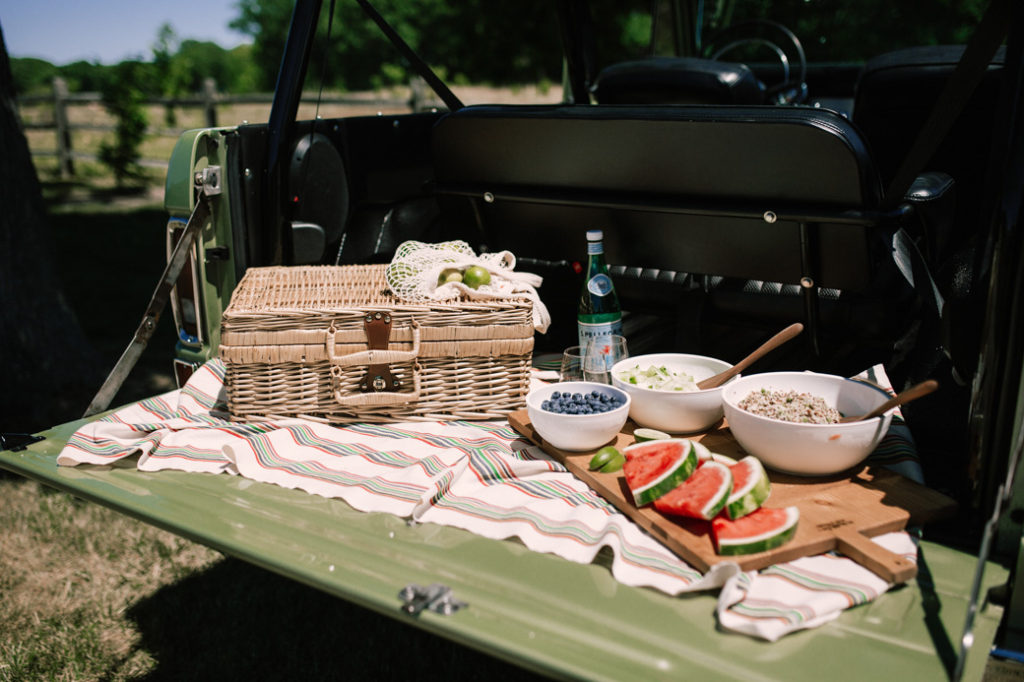 Picnic essentials including picnic basket, chilled serving bowls, Govino glasses and Turkish towels