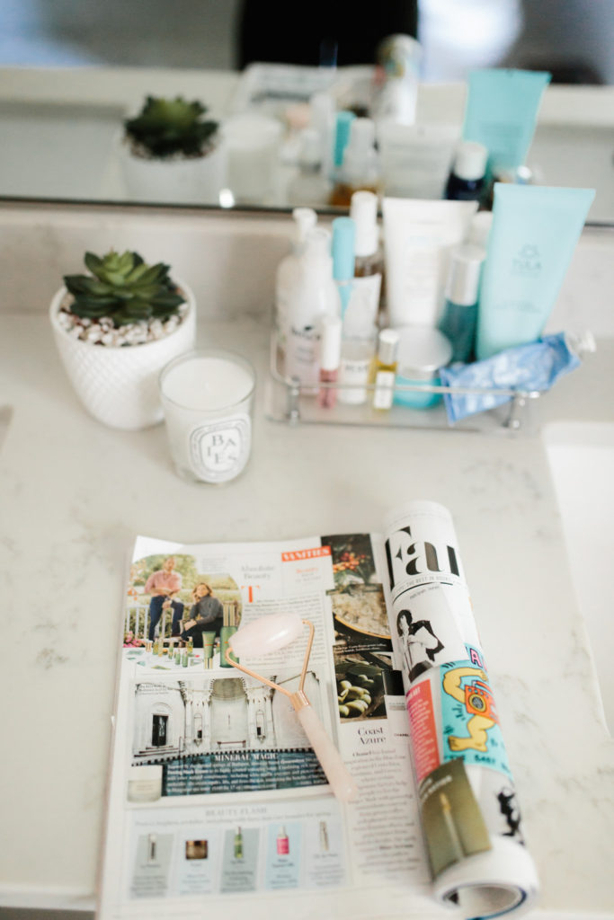 Rose Quartz Roller displayed on bathroom vanity