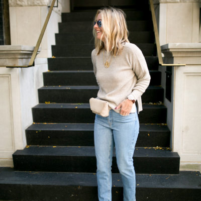 Cashmere sweater with suede belt bag, denim and faux snake skin mules