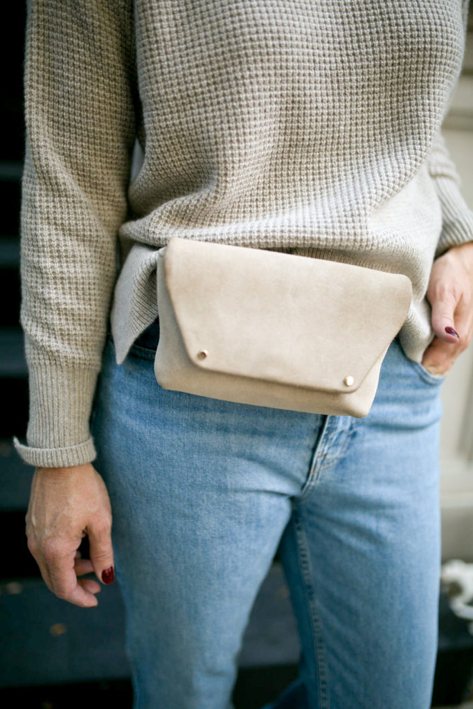 Cashmere sweater and belt bag in oatmeal