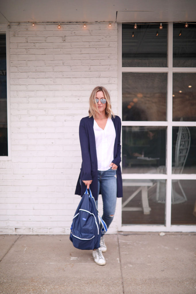 Megan Medica is wearing a Side Notch Pocket Duster Cardigan, and a white tee and jeans outfit