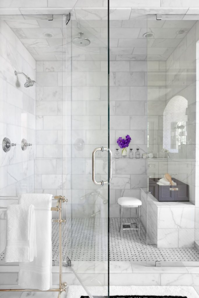 A large shower with rain overhead fixture and steam jets